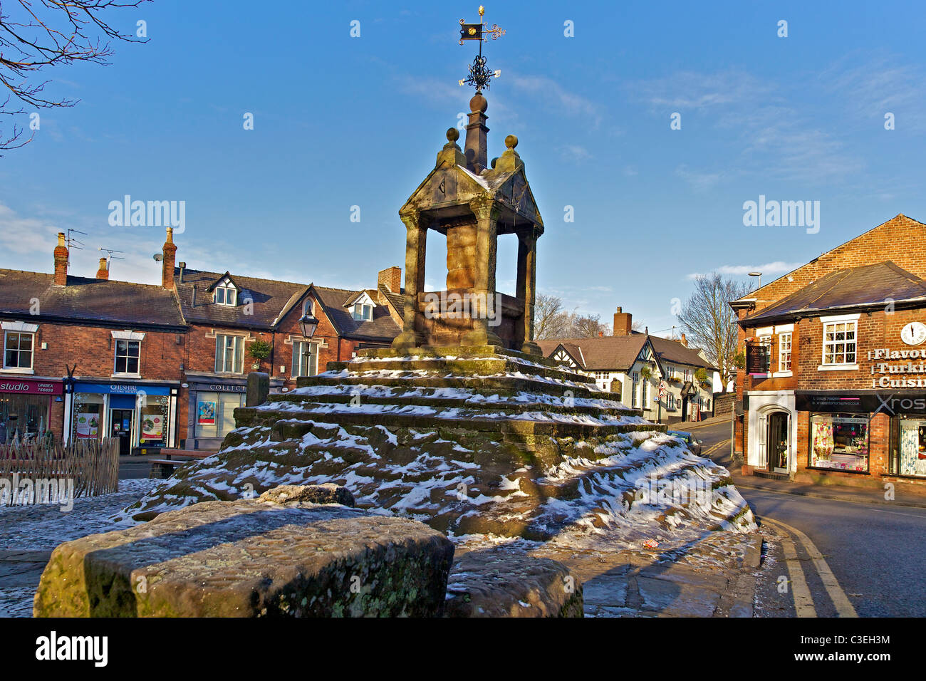 Lymm cross in the centre of Lymm village Cheshire in winter with snow. - Stock Image