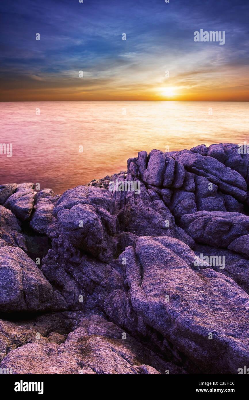 Dramatic sunset. Long exposure vertical shot. - Stock Image