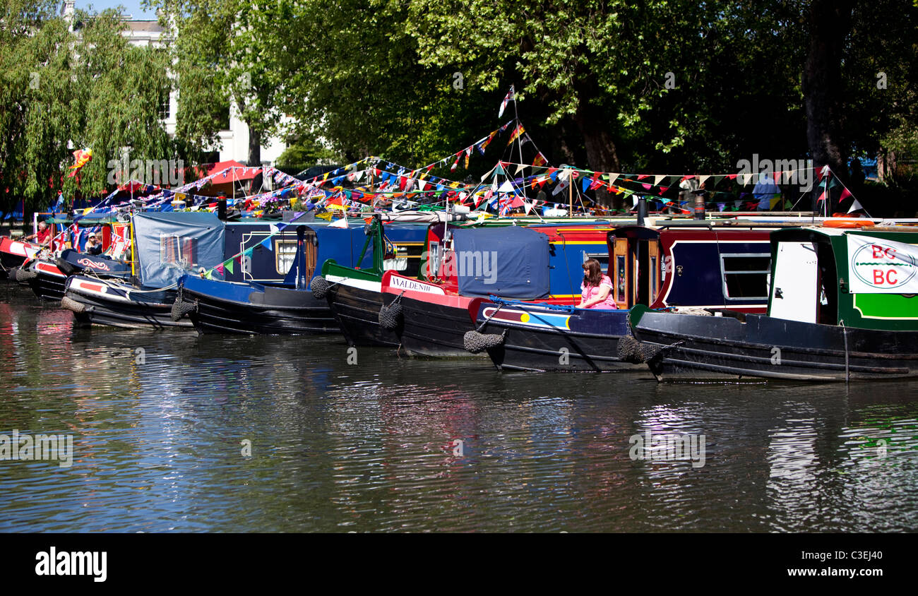 Narrowboats and barges docked in Regent's Canal at Little Venice, London, England, UK. - Stock Image