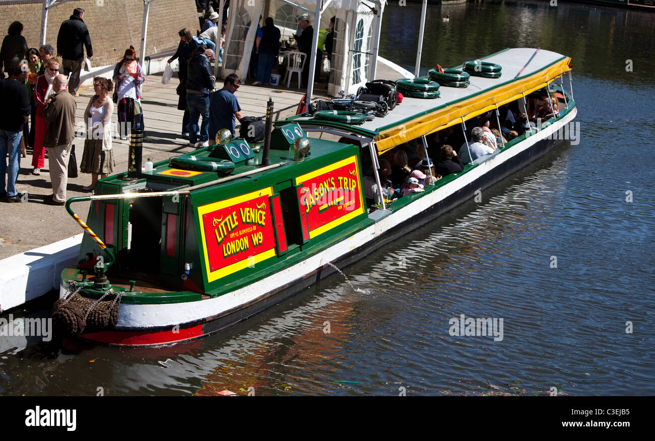 A trip narrowboat full of passengers, ready to depart, Regent's Canal, Little Venice, London, England, UK. - Stock Image