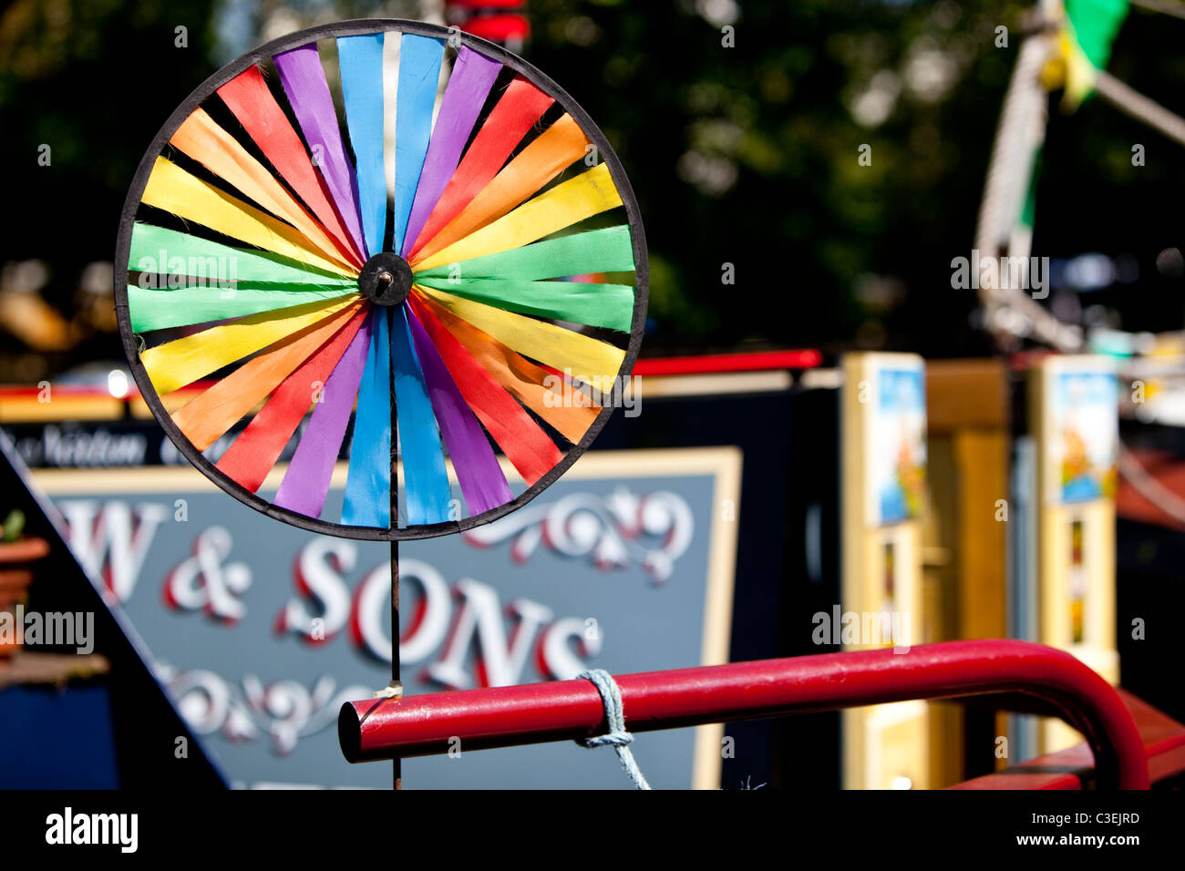 Wind spinner on a canal narrow boat, - Stock Image