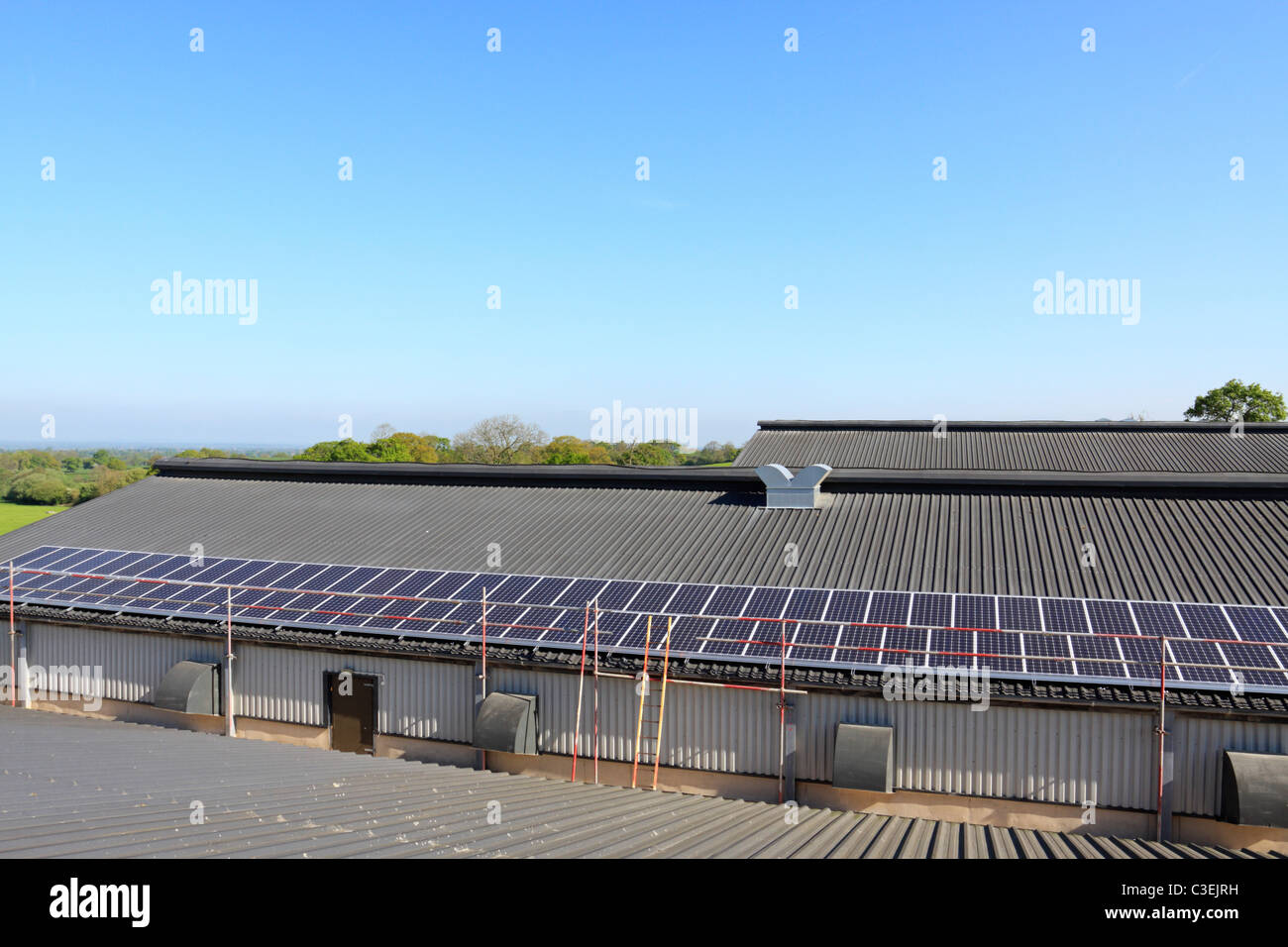 Part of a 50kWp solar photovoltaic installation on the roof of a poultry shed in Shropshire, UK - Stock Image
