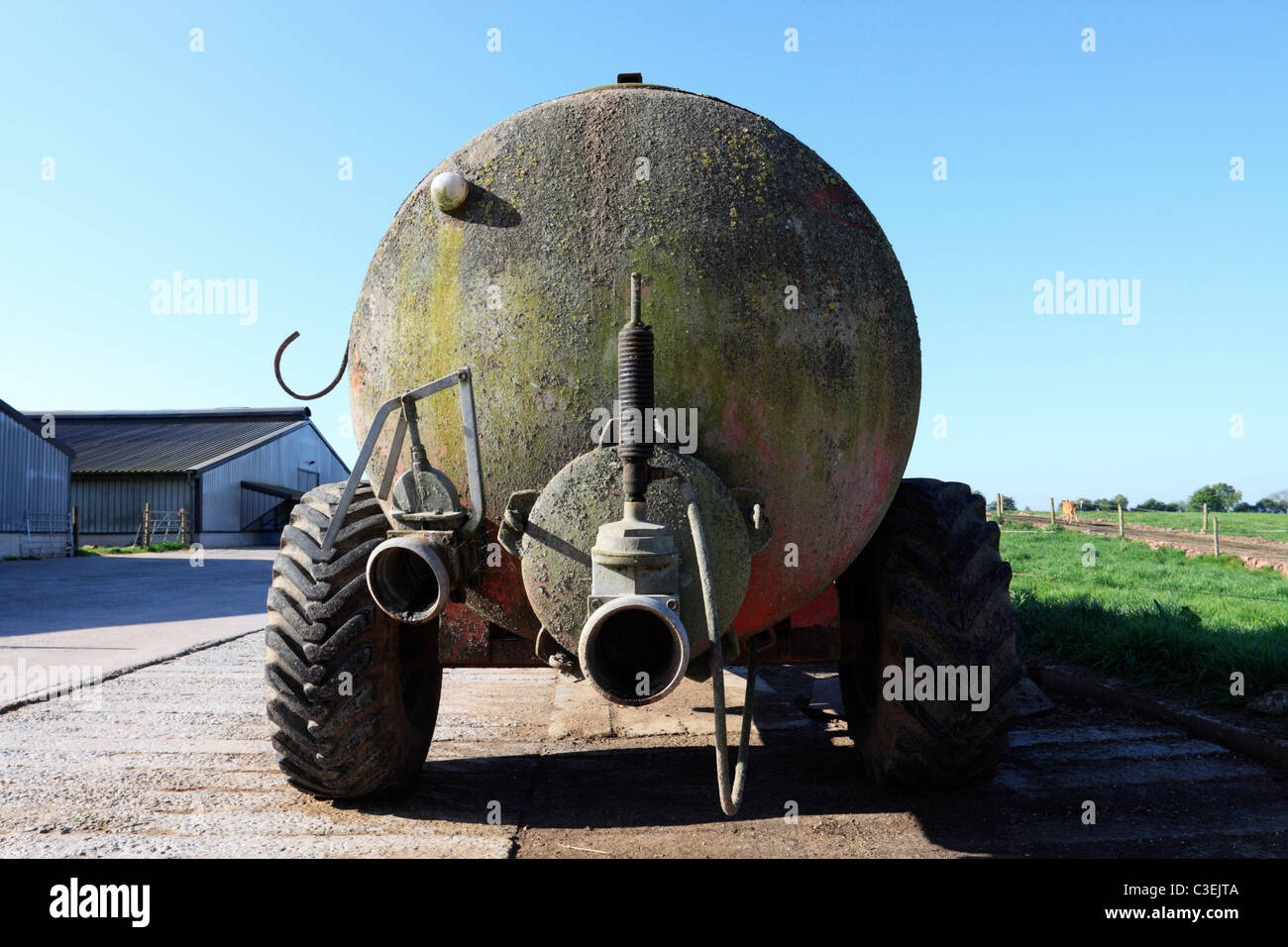 An aging slurry spreader parked on a Shropshire farm - Stock Image