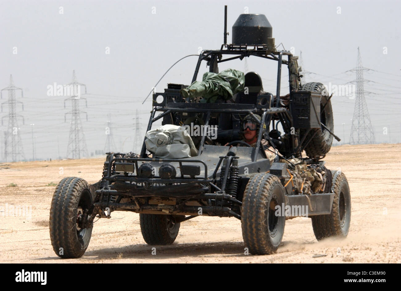 U.S. Navy SEALs team operate Desert Patrol Vehicles while preparing for an upcoming mission. - Stock Image