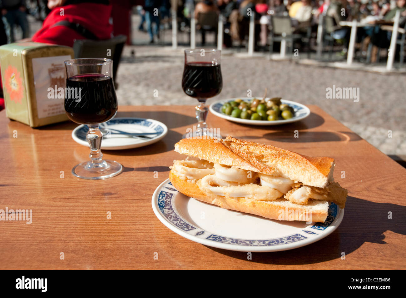 Fried squids sandwich at Plaza Mayor. Madrid, Spain. - Stock Image