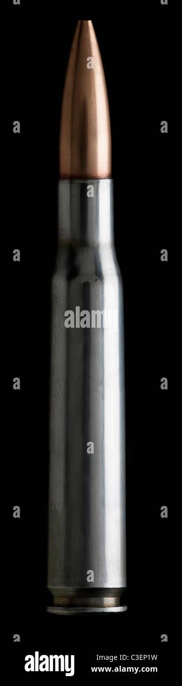 Single shot of rifle bullet on black - Stock Image
