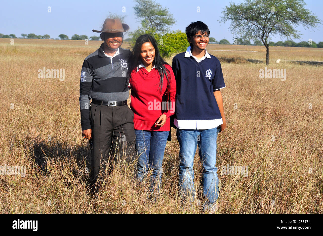 Wife, husband and son in an ecological park india - Stock Image