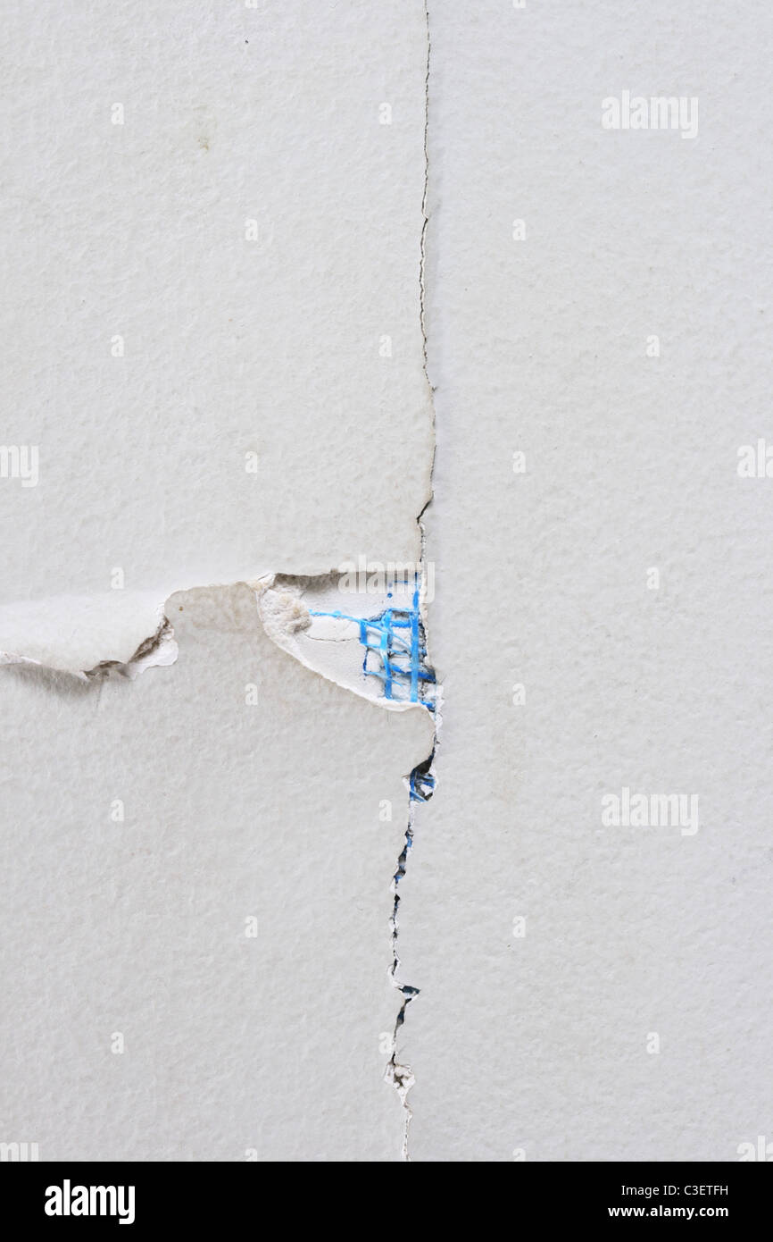 close up of cracked sheet rock wall for background texture - Stock Image
