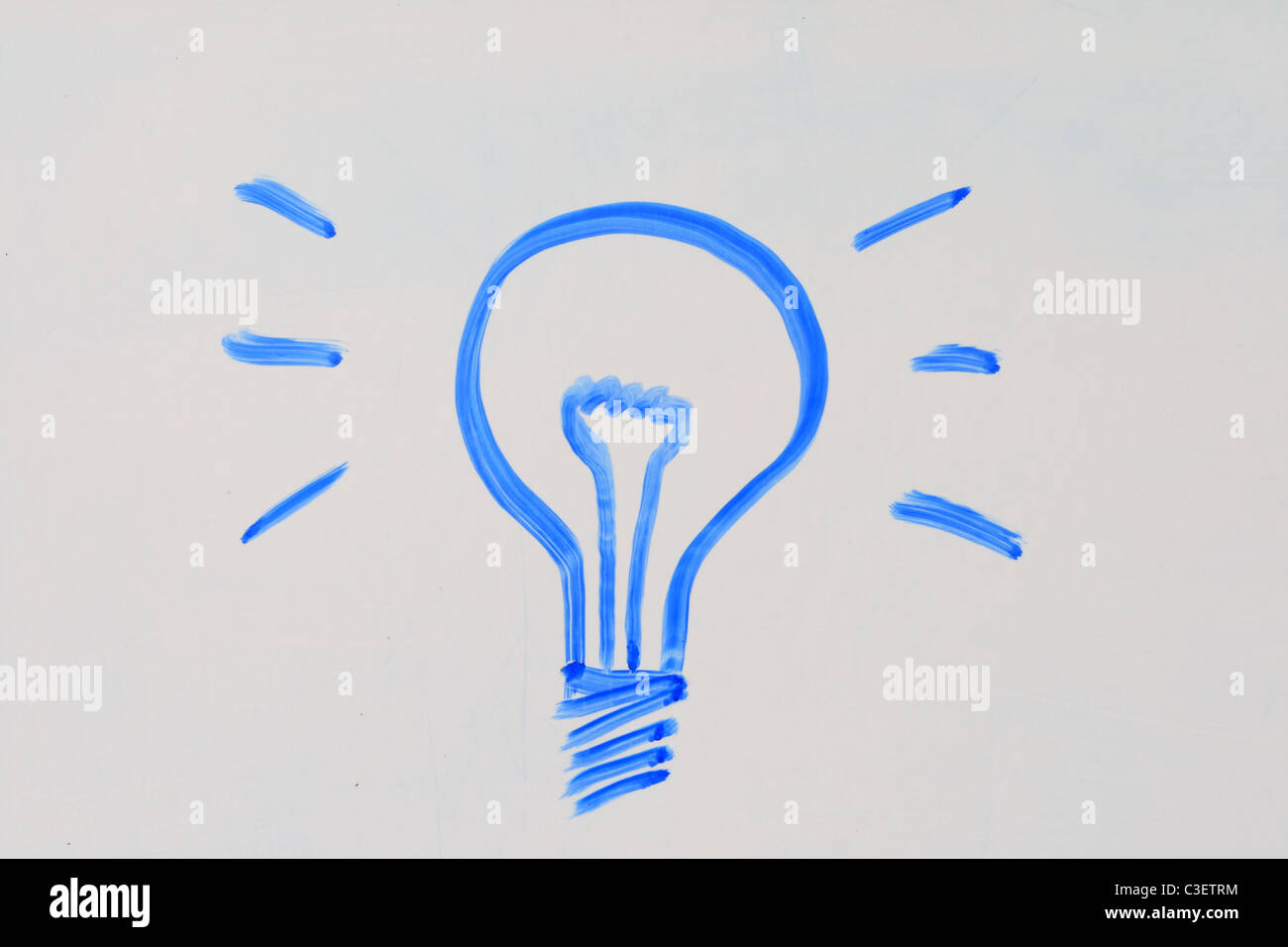 lightbulb drawn in blue marker on a white board - Stock Image