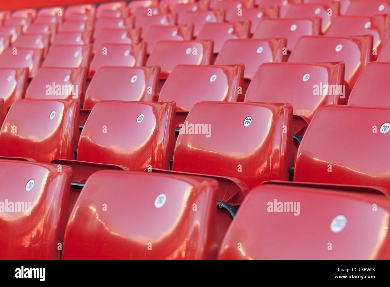 Empty seats at Old Trafford football stadium in Manchester, England - Stock Image