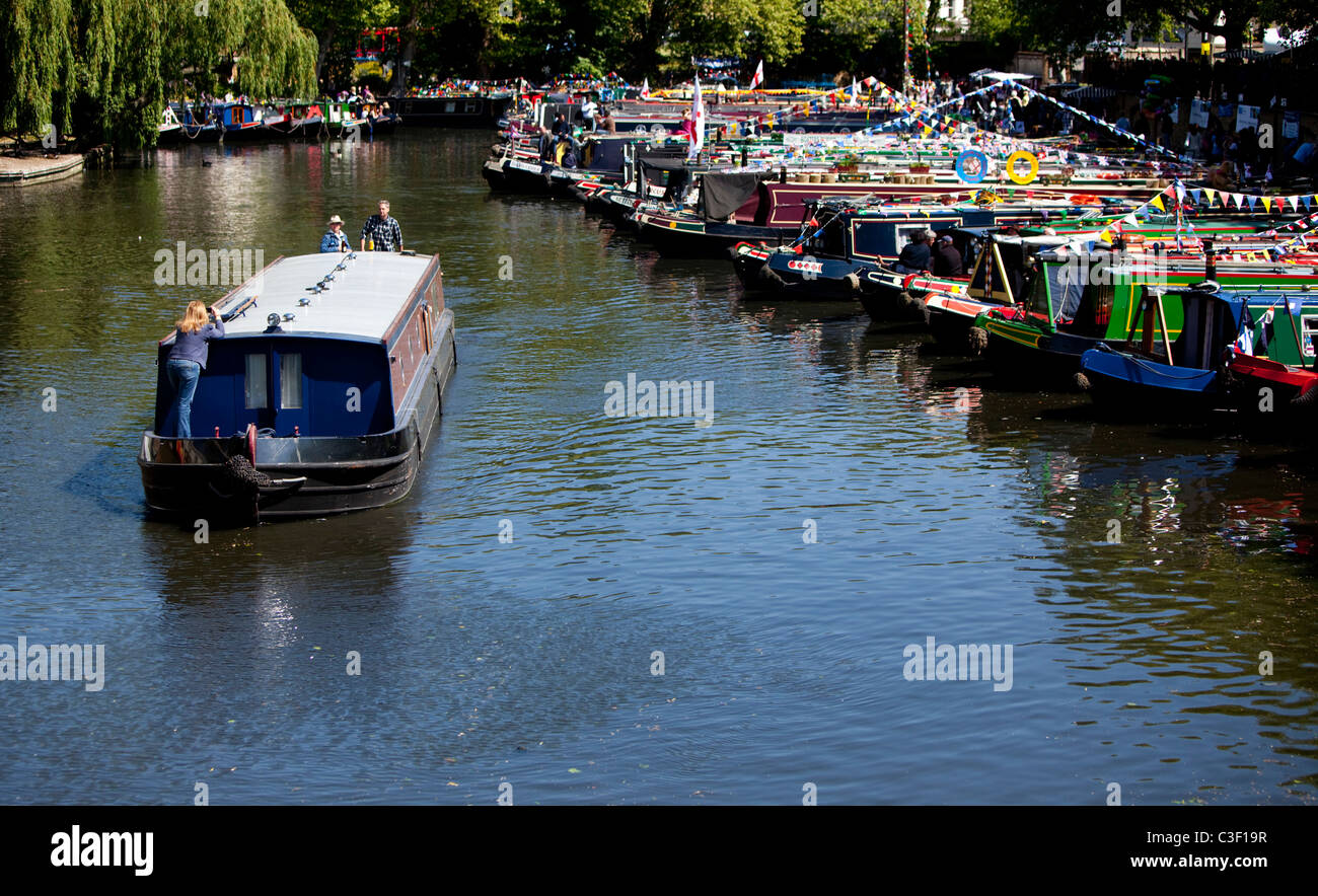 Narrowboat traveling down Regent's Canal at Little Venice, London, England, UK - Stock Image
