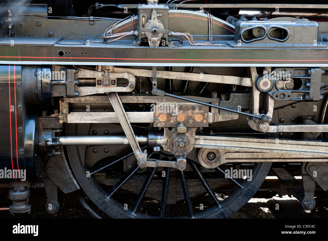 Wheel and connecting rod detail on U Class locomotive no 31806, Mid Hants Railway, Alresford, Hampshire, England, - Stock Image