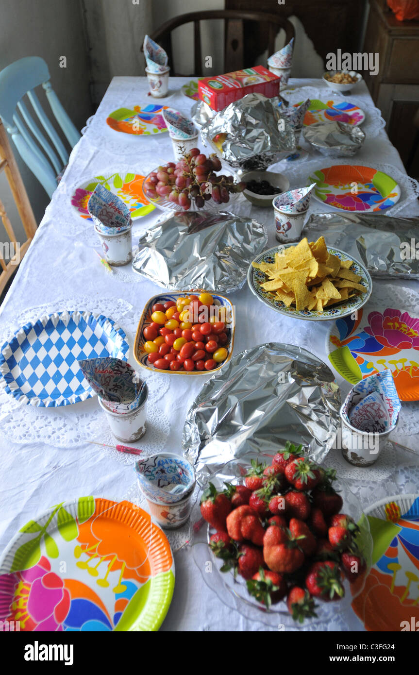 A table laid for a child's birthday party - Stock Image