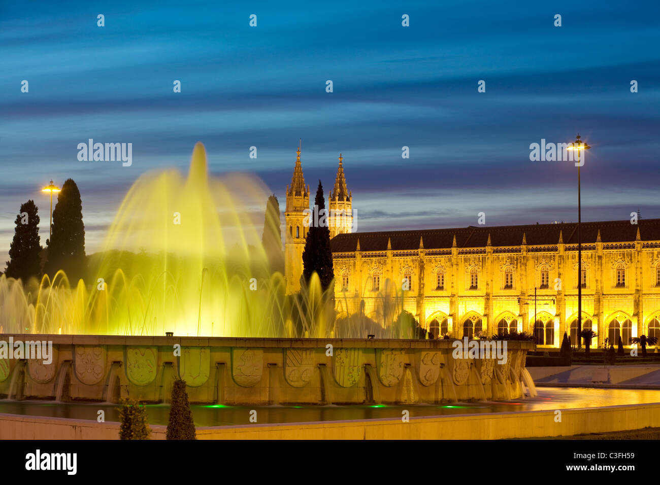 Jeronimos Monastery and fountain in Imperial Plaza, Belem, Lisbon, Portugal - Stock Image
