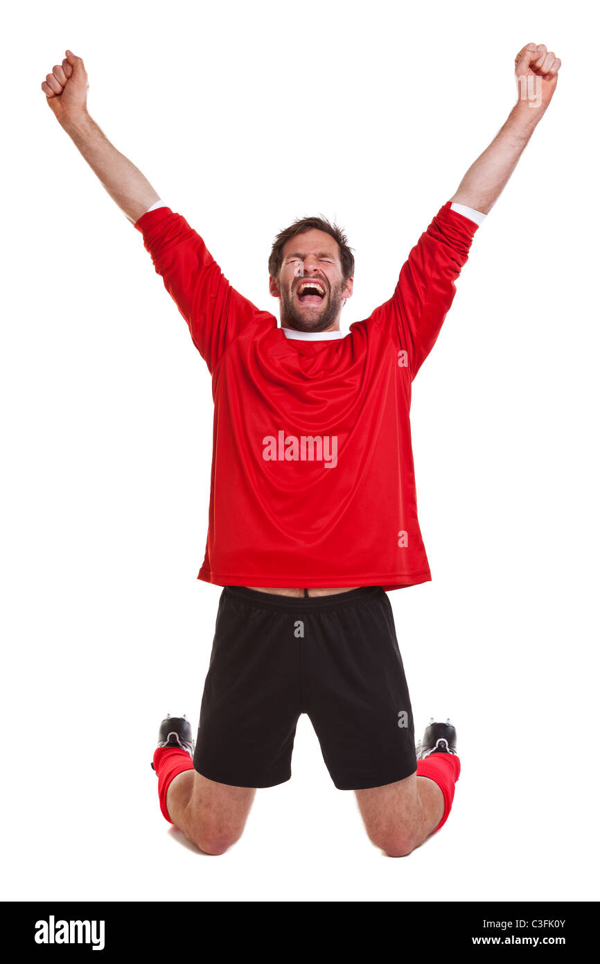 Photo of a footballer or soccer player cut out on a white background,. - Stock Image