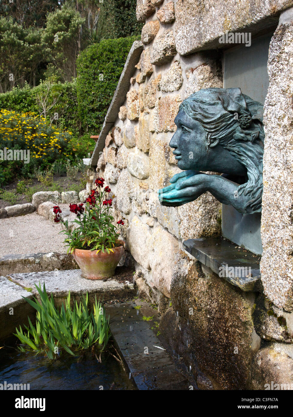 Bronze water nymph fountain and pool at Tresco Abbey Gardens on the Isles of Scilly Stock Photo
