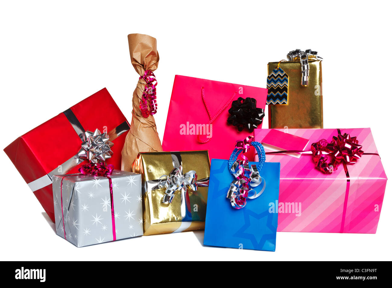 Photo of a group of wrapped gift presents cut out on a white background. - Stock Image