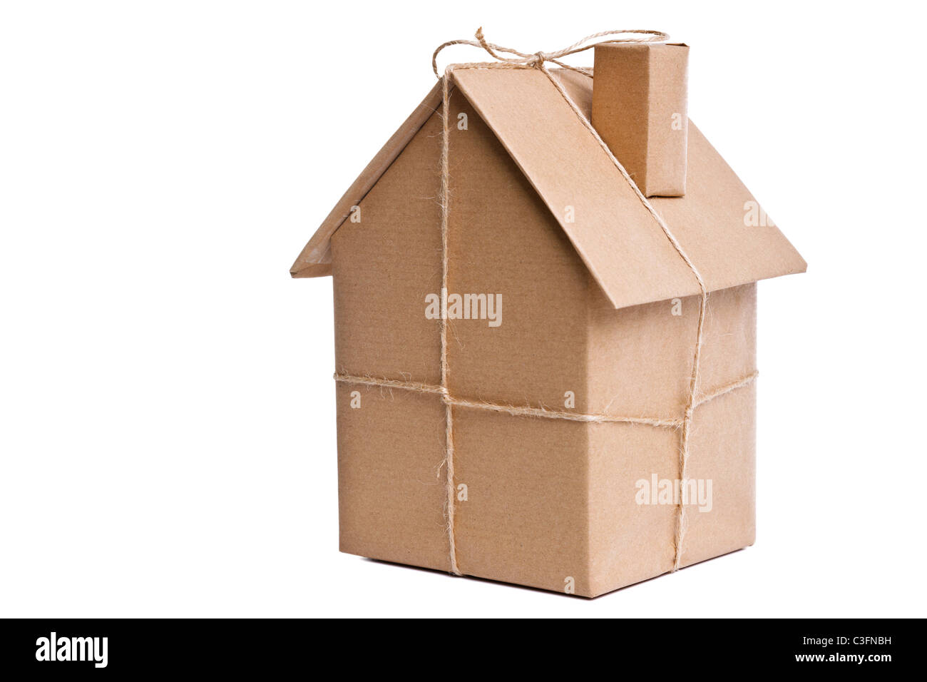 Photo of a wrapped house in brown recycled paper, cut out on a white background. - Stock Image