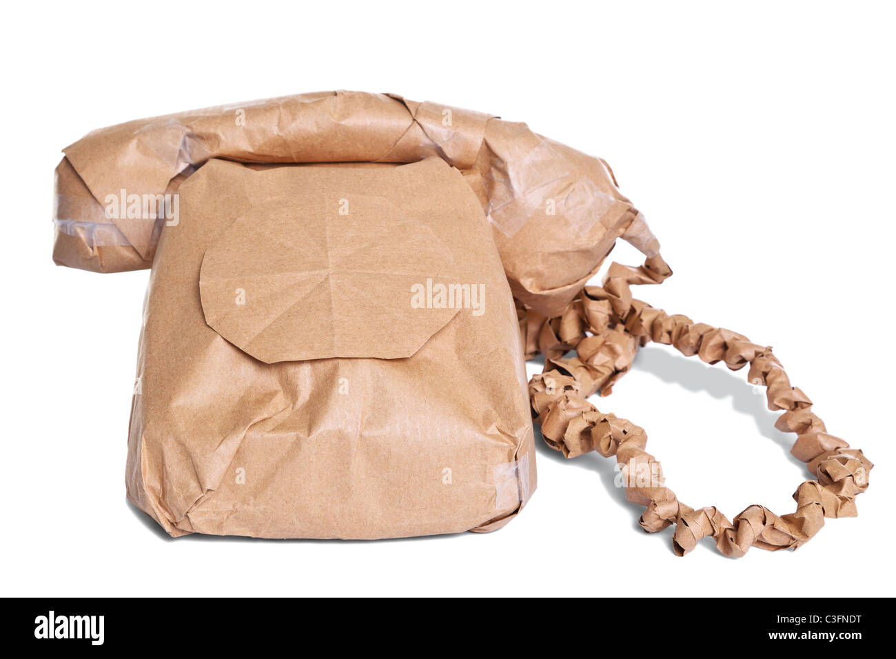 Photo of a telephone wrapped in brown recycled paper, cut out on a white background. - Stock Image
