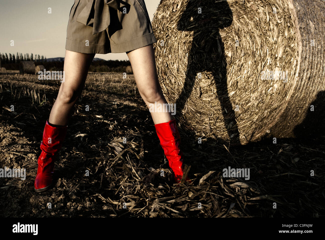 Girl in red wellington boots in field Stock Photo