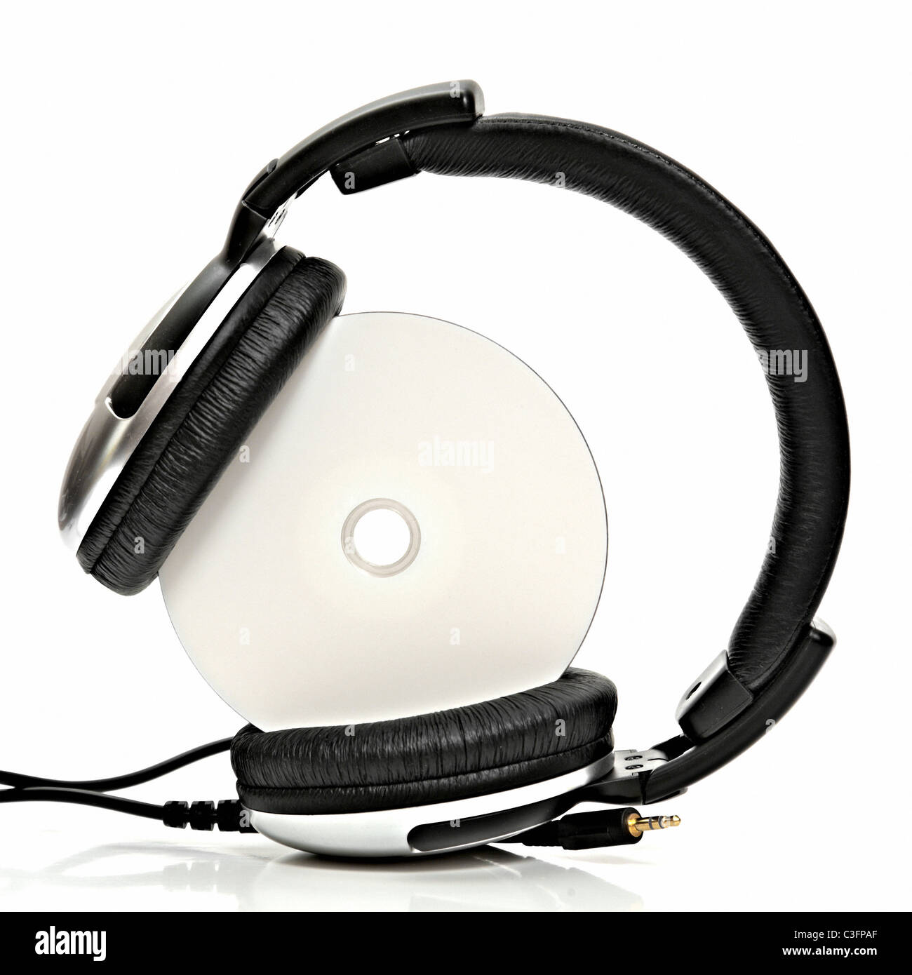 headphones with compact disc - Stock Image