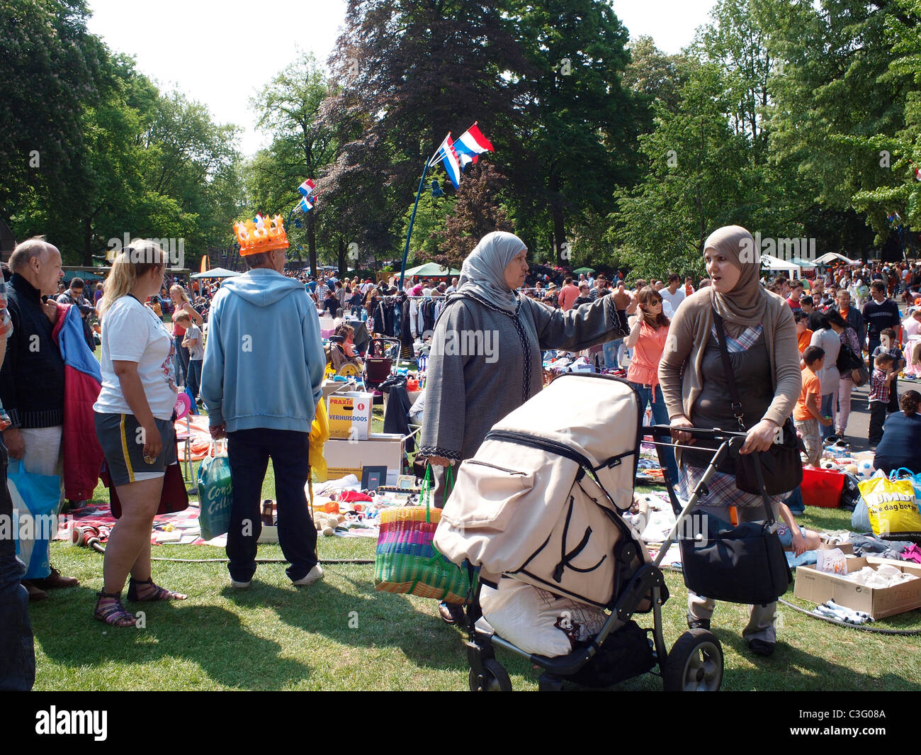 Integration, muslim women visiting the flea market on april 30th, queen's day, in Valkenberg park in Breda, - Stock Image