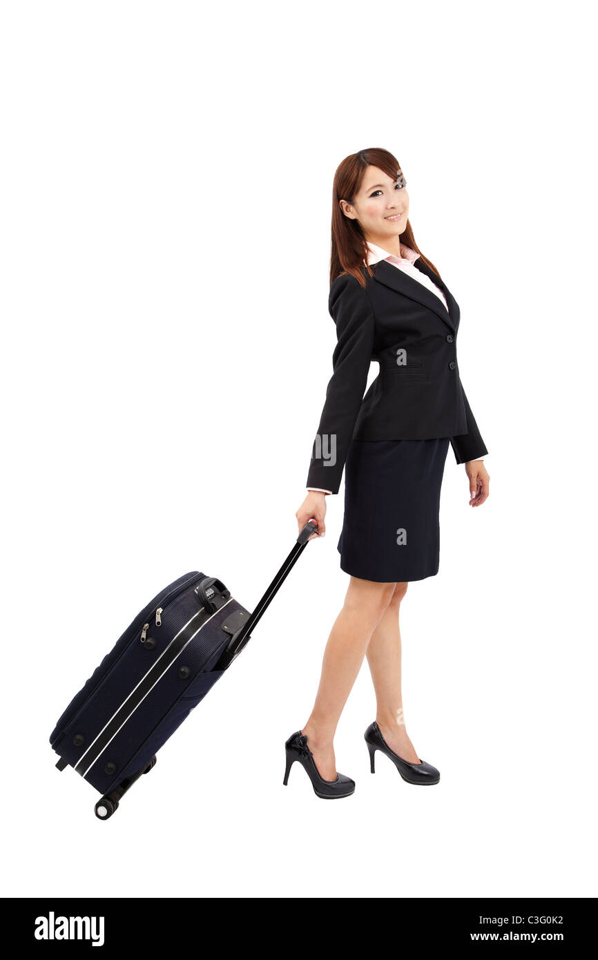 business woman traveling with suitcase - Stock Image