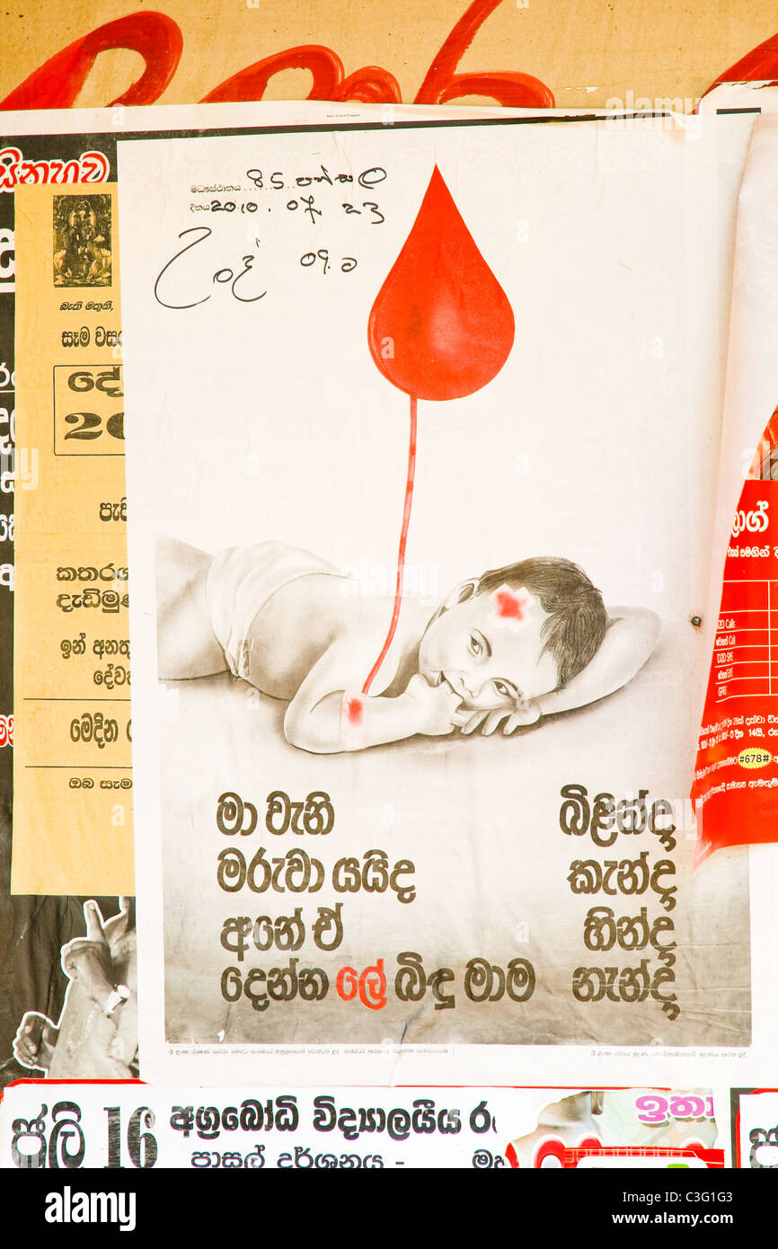 A Sri Lankan 'give blood' poster, displayed all over the island. - Stock Image