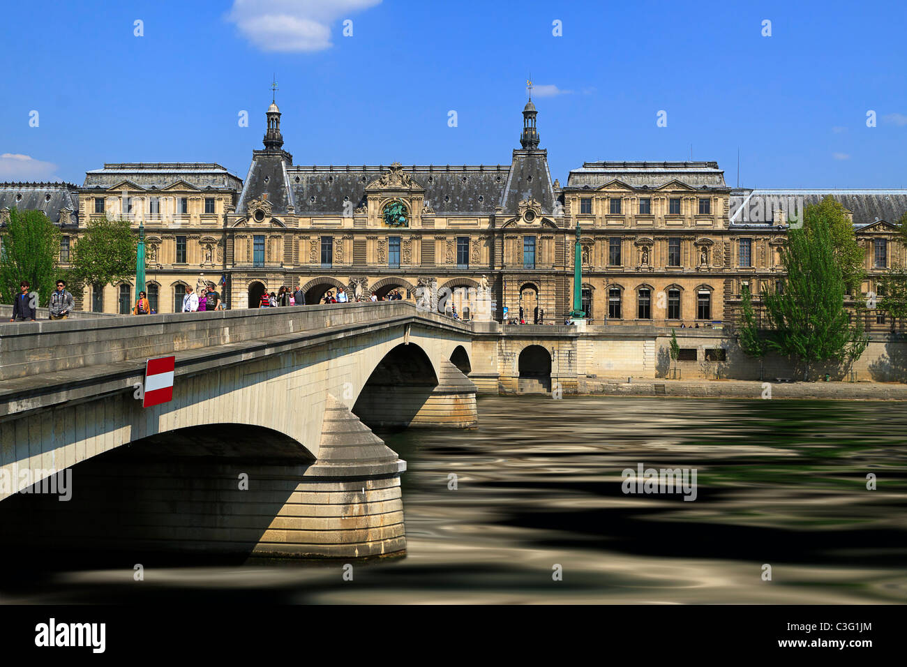 Pont du Carrousel, Seine River, and Musee du Louvre. Built in the 20th century to replace the original 19th century - Stock Image