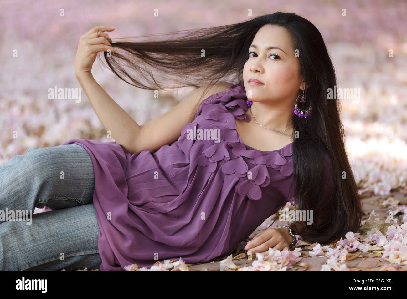 https://c8.alamy.com/comp/C3G1XP/beautiful-asian-thai-woman-lying-on-flowers-and-pulling-long-hair-C3G1XP.jpg