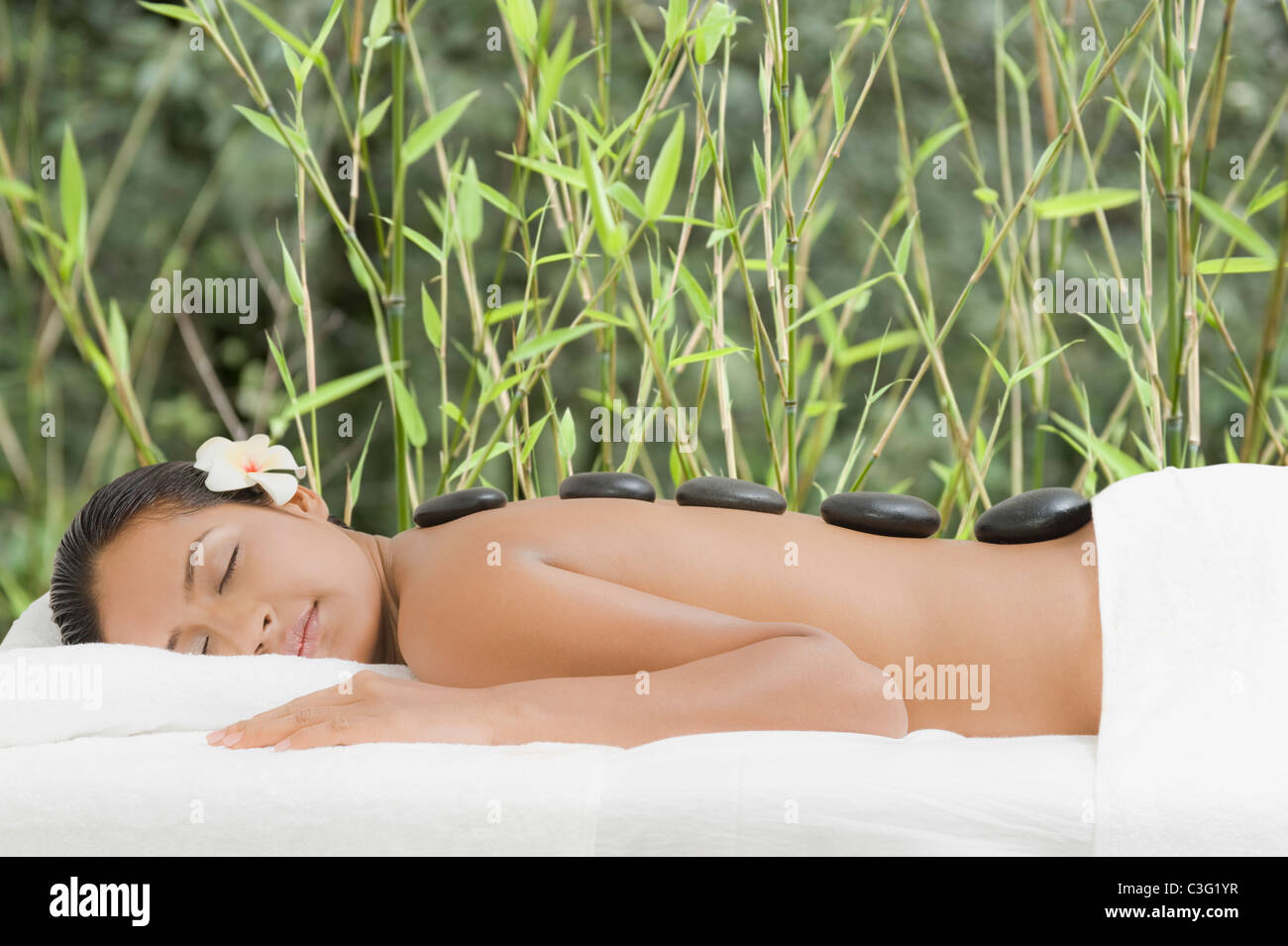 Woman getting lastone therapy - Stock Image