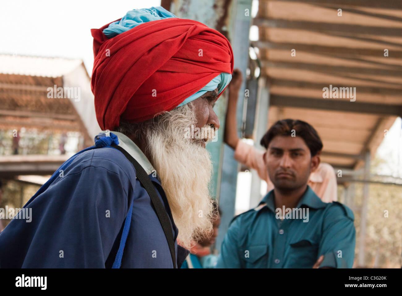 People at a railway station, Ahmedabad, Gujarat, India - Stock Image