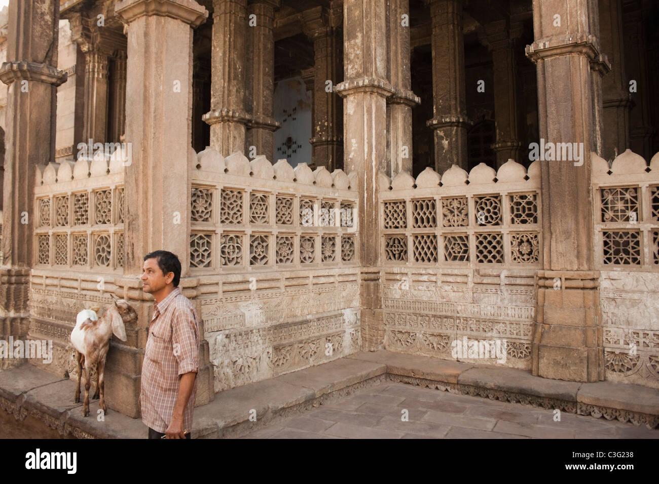 Man standing near a building, Ahmedabad, Gujarat, India - Stock Image