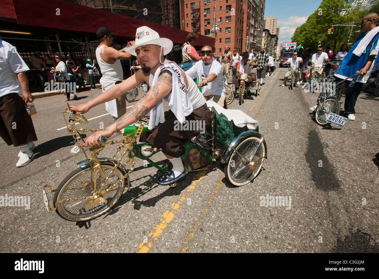 Members of the Brown Life bicycle club in the Cinco de Mayo Parade in New York - Stock Image