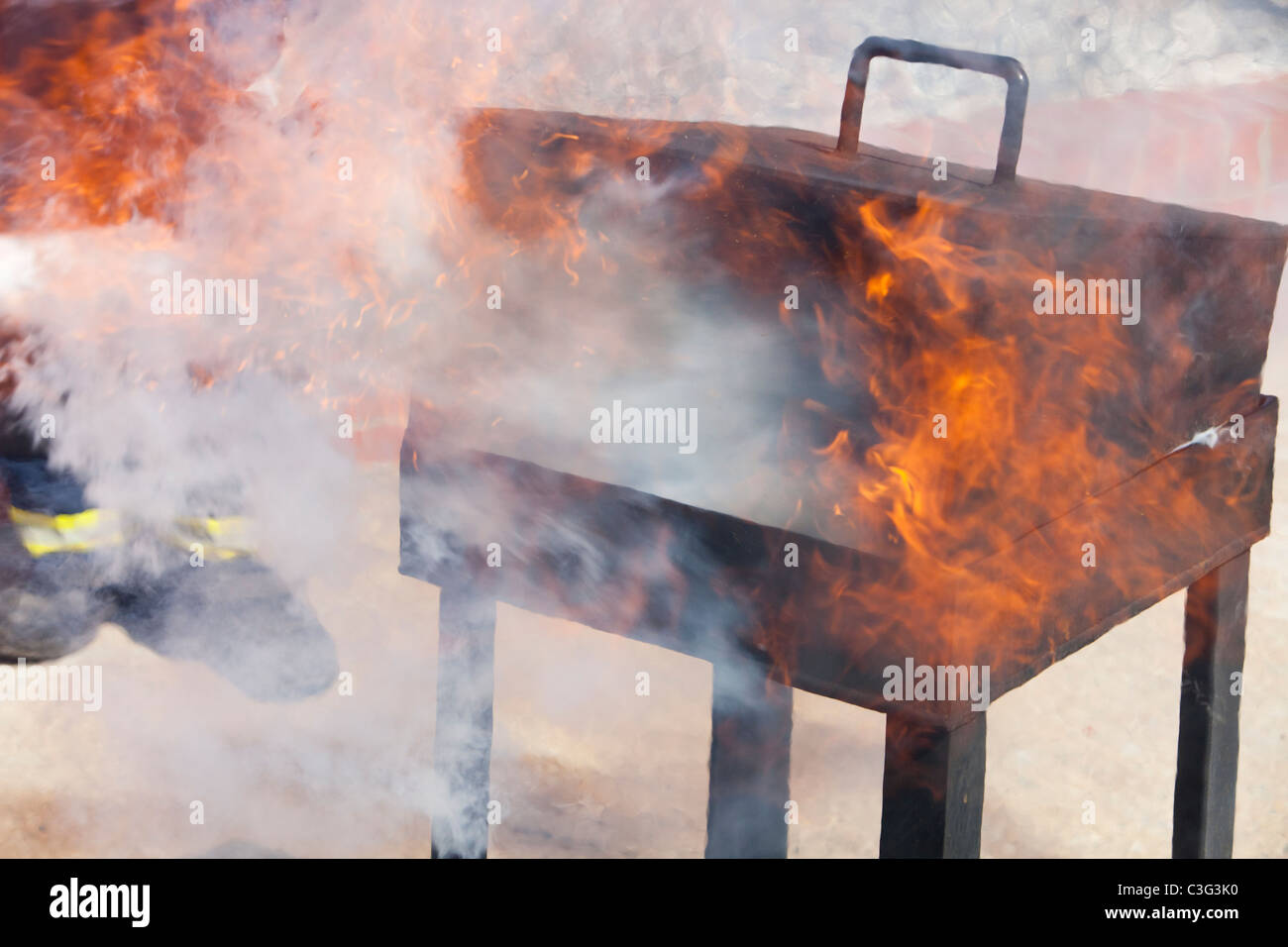 Fighting a fire with a C02 fire extinguisher. - Stock Image