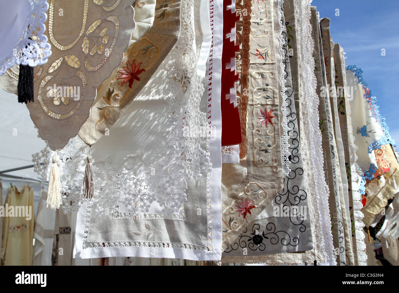 fabric embroidery tablecloths mediterranean in a row - Stock Image