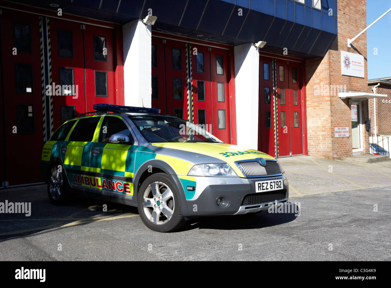 fast response paramedic emergency ambulance vehicle parked outside a fire station in holywood county down northern - Stock Image