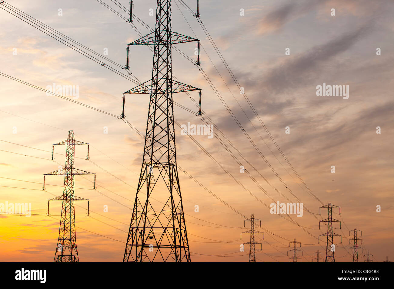 Power lines and pylons at sunset in Billingham, Teeside, UK. - Stock Image