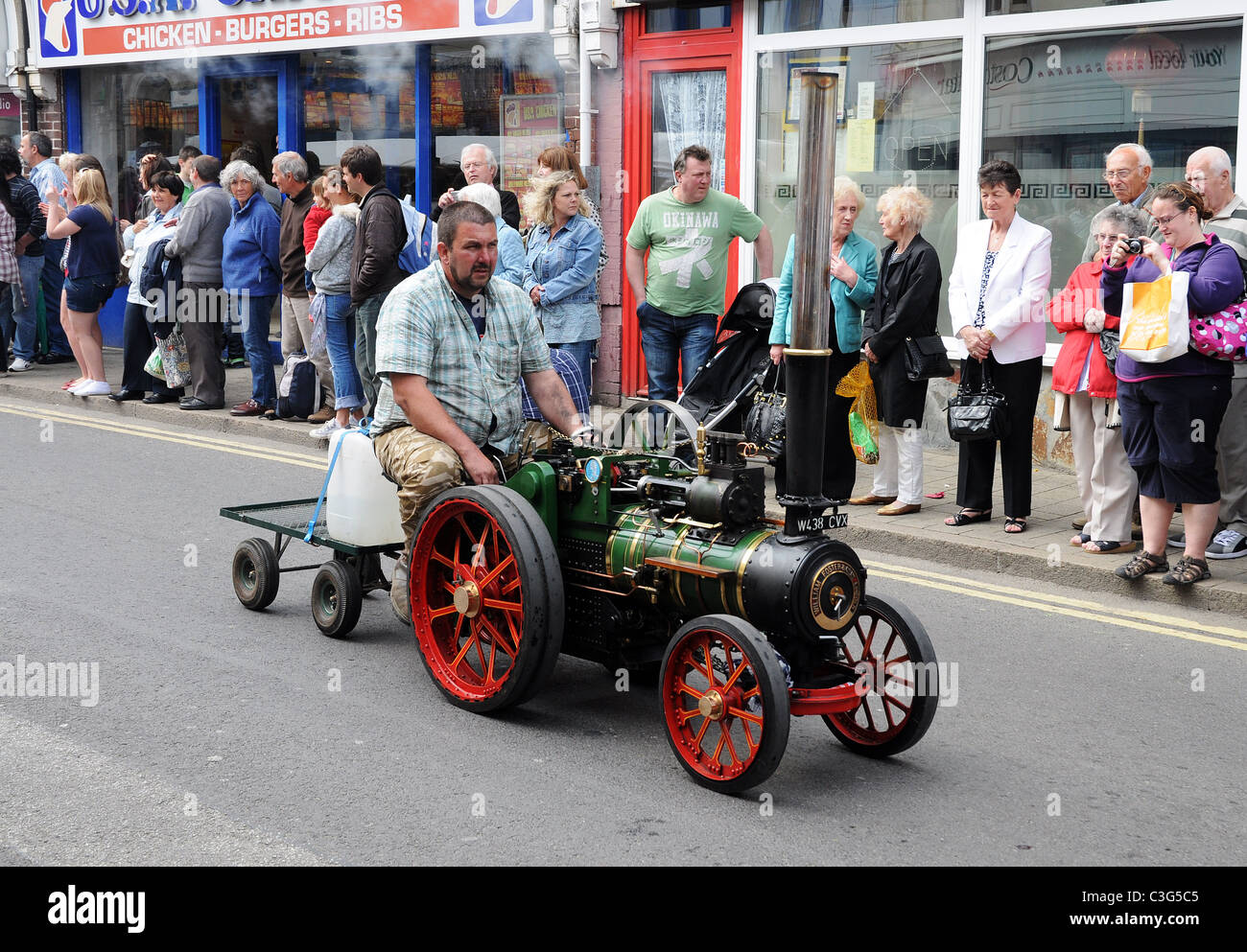 A scale model steam engine in the annual Trevithick day parade in Camborne, Cornwall, UK - Stock Image