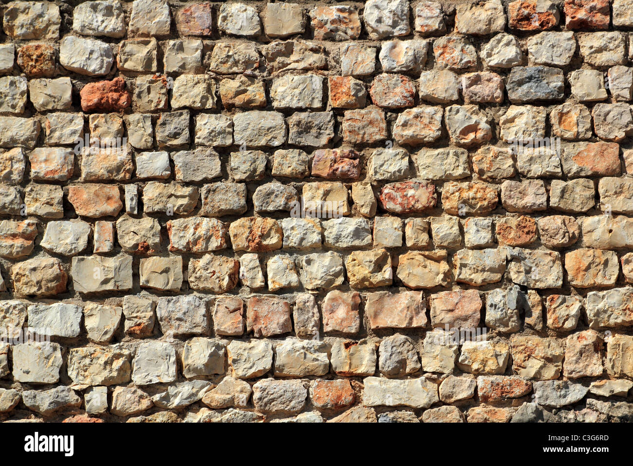 brown masonry stone wall Spain traditional ancient construction - Stock Image