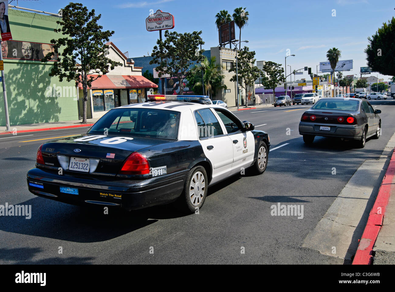 Car being pulled over by a police officer. - Stock Image