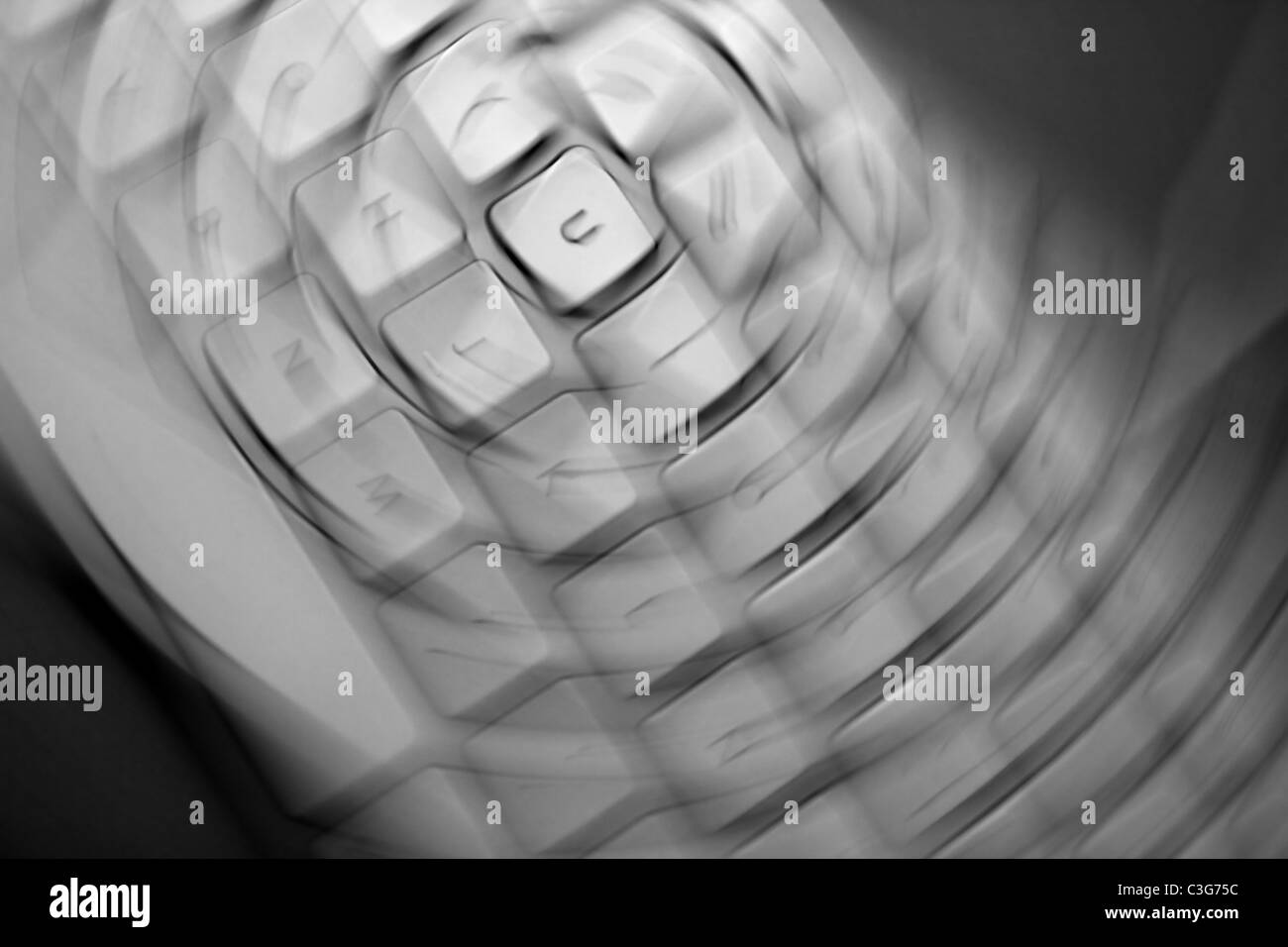 crazy keyborad motion blurred keys as a disease metaphor - Stock Image