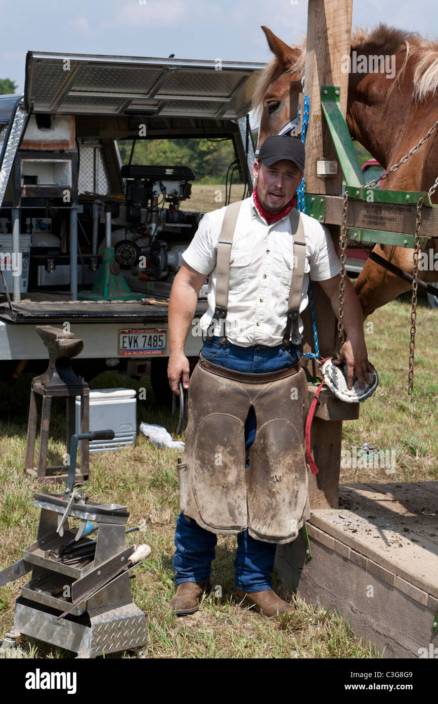 Blacksmith explaining to audience what he is doing - Stock Image