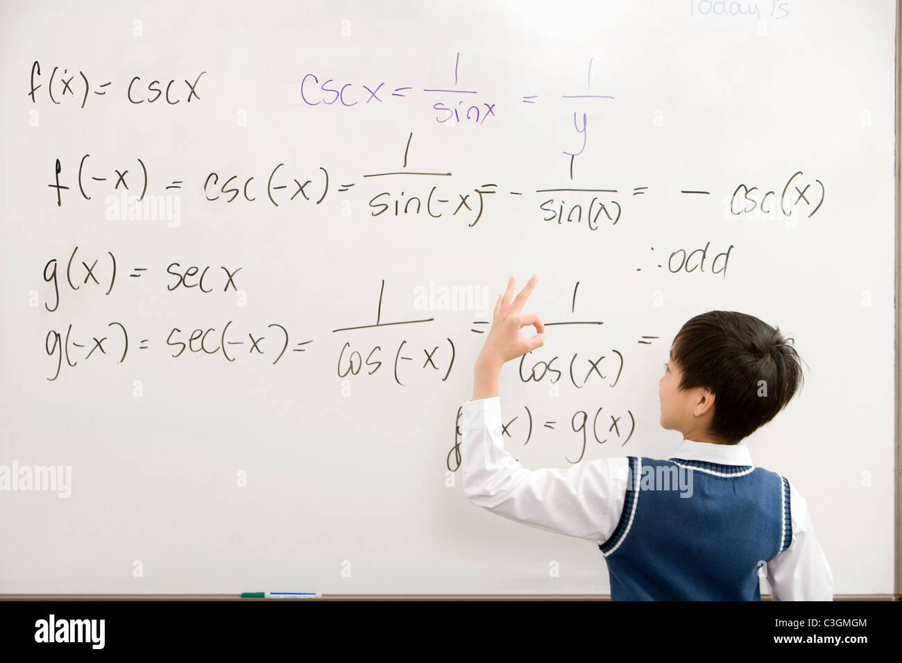 Student doing a math on the whiteboard Stock Photo: 36632084 - Alamy