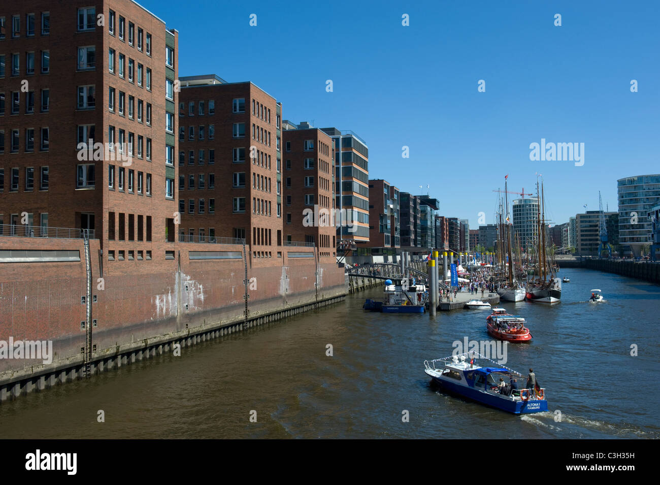 Sandtorkai office blocks and the traditional ship harbour at HafenCity Hamburg in Germany - Stock Image