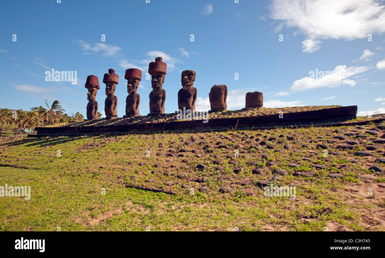 Moais with topknots at Ahu Nau Nau, Easter Island. - Stock Image