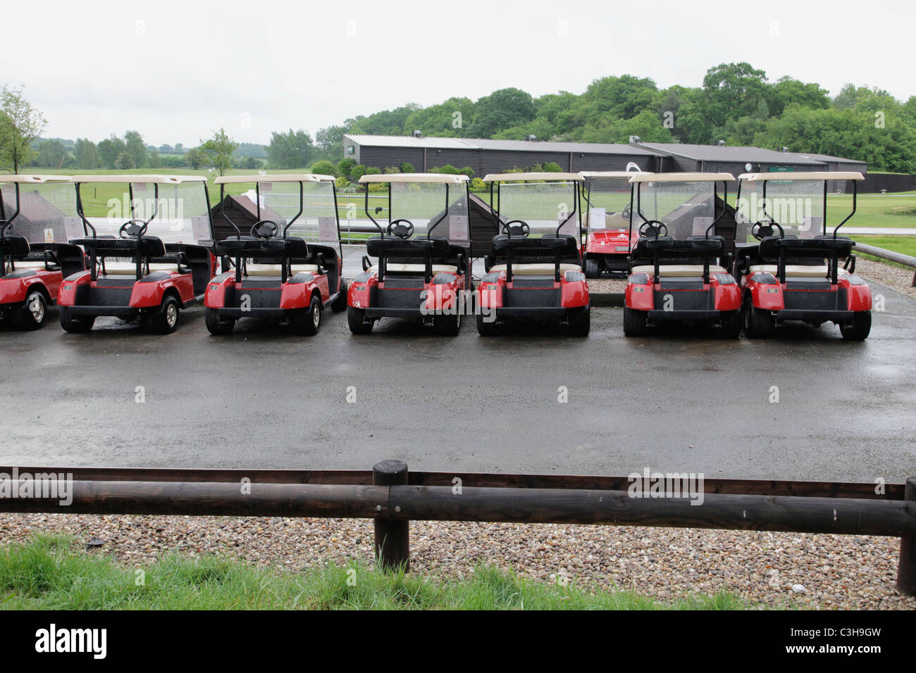 Row of golf buggies being recharged at Forest of Arden Country Club Birmingham - Stock Image