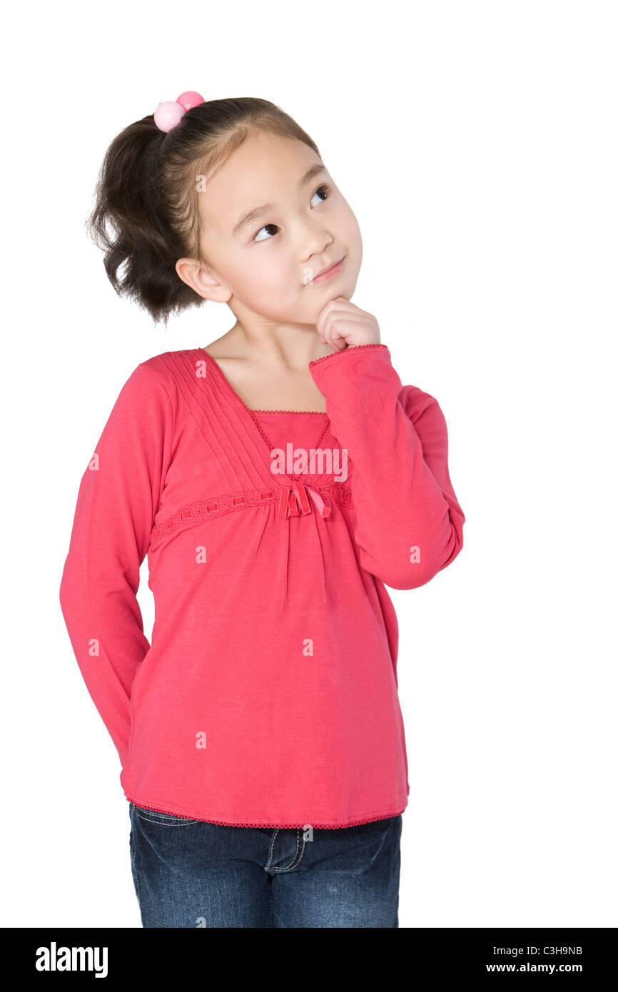 Young girl looking up thinking - Stock Image