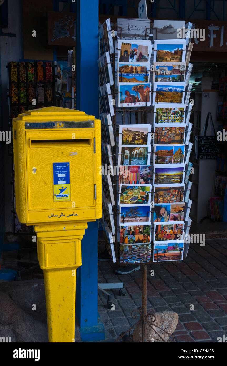 Postcards and postbox Medina old town Essaouira central Morocco northern Africa - Stock Image