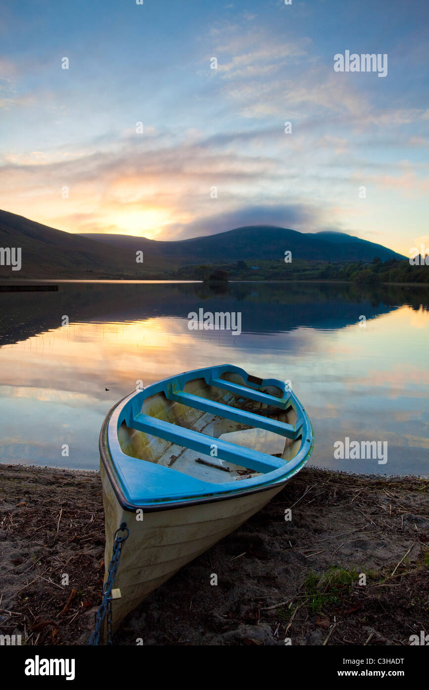 Evening fishing boat on the shore of Lough Talt, County Sligo, Ireland. - Stock Image